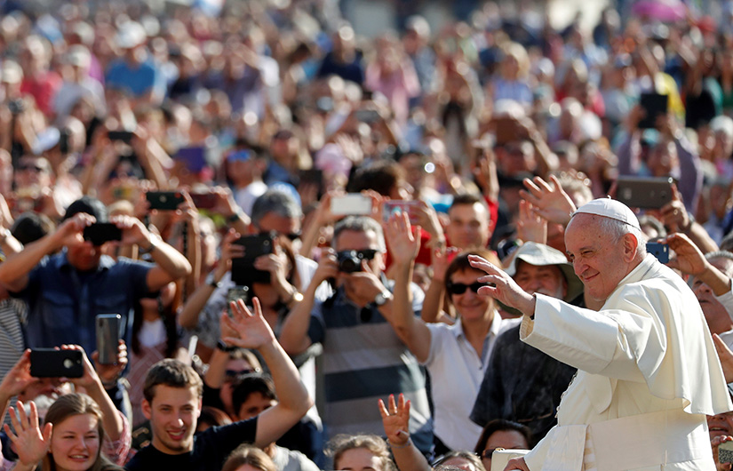 Pope Francis greeted pilgrims as he arrived for his general audience in St. Peter's Square at the Vatican Oct. 2.