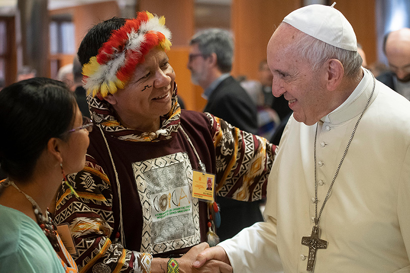 Pope Francis greeted people during the Synod of Bishops for the Amazon at the Vatican Oct. 8.