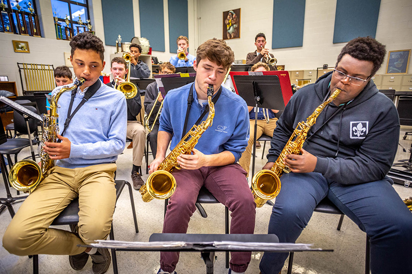 Cody Cox, Aiden Lundergan and David Thuita played the tenor saxophone with members of the Saint Louis University High School jazz band Oct.21 as they practiced for an upcoming performance.