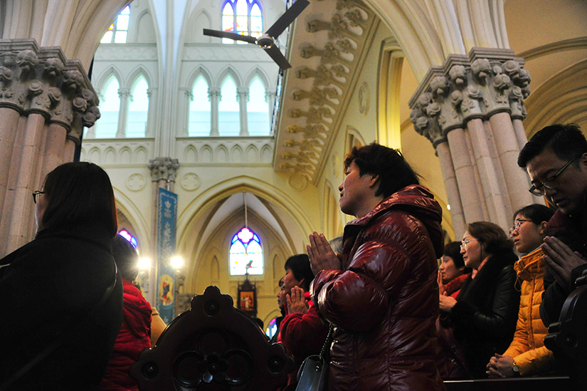 People prayed during Mass at St. Ignatius Cathedral in Shanghai in 2017.