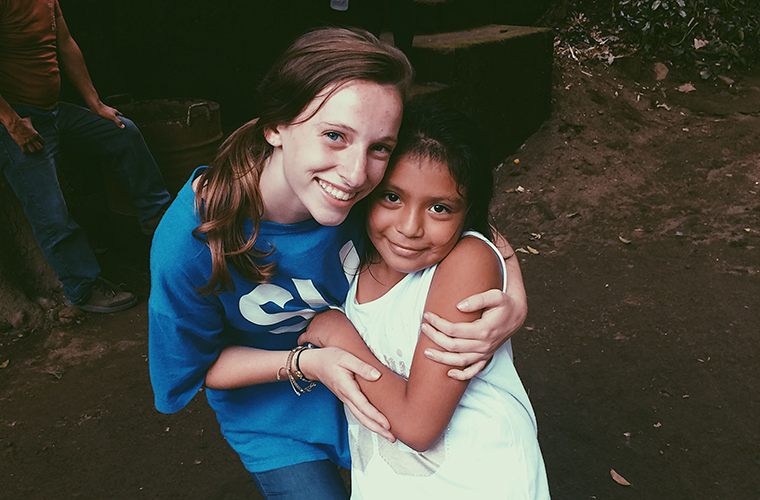 Suzy Kickham visited with a 7-year-old friend she made while volunteering in a children's program in a village in Nicaragua. Kickham, a St. Louis University student, said she appreciated the beauty and challenges she found in the Central American country thanks to a program in memory of a 1985 graduate of SLU, Mev Puleo.