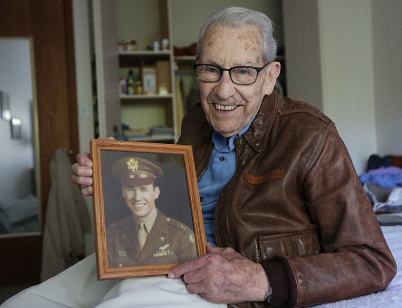 Don Stoliel of Sacred Heart Parish in Robbinsdale, Minn., held a picture of himself that was taken near the end of his tour of duty in World War II as a B-17 bomber pilot. He carried a relic of St. Therese of Lisieux in the cockpit during all of his 31 missions and credits the saint for his survival.
