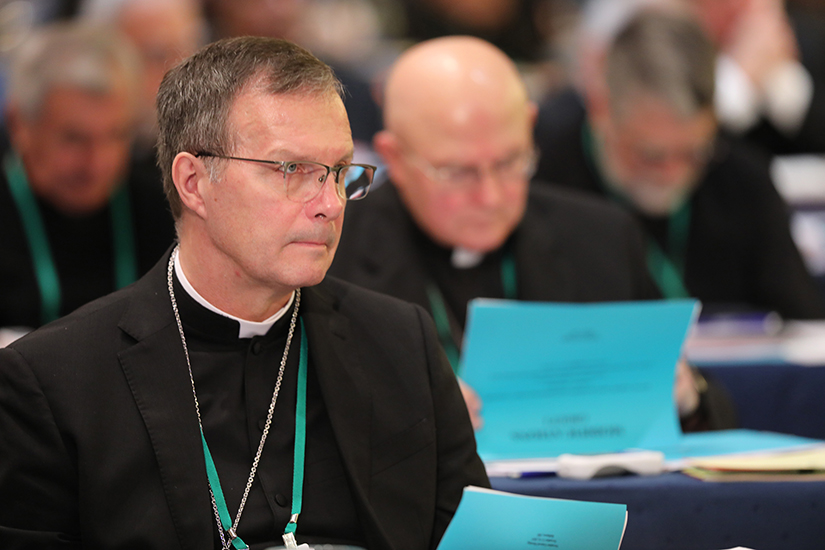 Bishop William M. Joensen of Des Moines, Iowa, listened to a speaker during the fall general assembly of the U.S. Conference of Catholic Bishops in Baltimore Nov. 11.