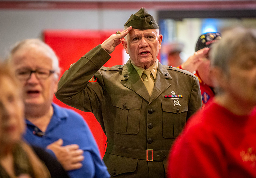Retired U.S. Marine Corps Sgt. Mike Sappington saluted during the pledge of allegiance at a program honoring military veterans at St. Matthias Catholic Church on Nov. 11.