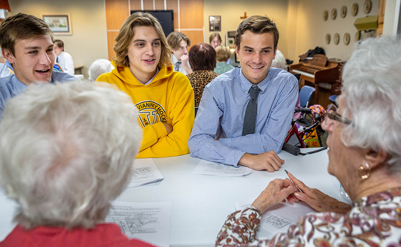 Nick Pinkston, Collin Wobbe and John Allen, students from St. John Vianney High School, visited Jeanette Kouba and Mary Ann Carmody to teach them about cyber security at Our Lady of Life Apartments on Oct. 29.