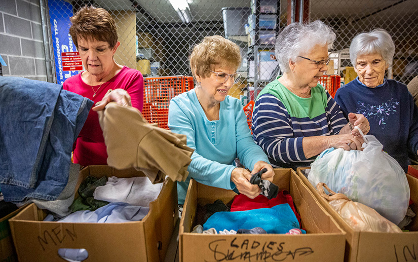 "From left, Judy Brusselback, Gerri Zeman, Linda Winkler and Anna Brueckner joined the other ""Rag Ladies"" in sorting and boxing donations at Queen of All Saints Parish in Oakville Nov. 4. The Rag Ladies sort through donations to the parish's St. Vincent de Paul Society to ensure they are in good condition and then organize them."