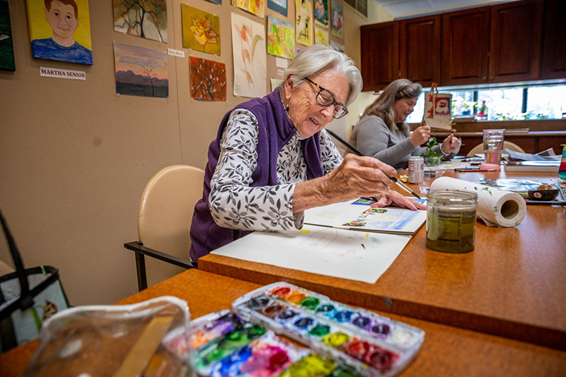 Berkeley Gunther painted a water color image of the Jewel House during art class at The Gatesworth in University City on Nov. 5.