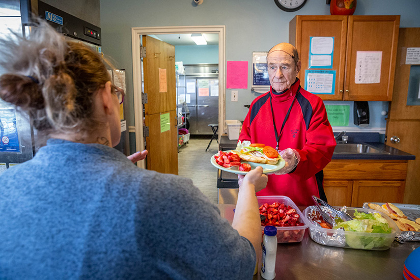"Don Nary served lunch to residents at Our Lady's Inn in St. Louis. He and his wife, Alverne (""Al"") have volunteered at the maternity home for a decade."