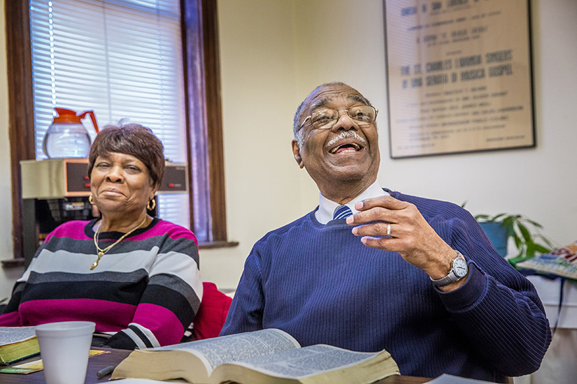 Queen Esther Frazier, left, and Richard Watkins enjoyed a lively discussion at a Bible study group at the St. Charles Lwanga Center two years ago. Frazier still attends the center's Bible study with Father Art Cavitt each week.