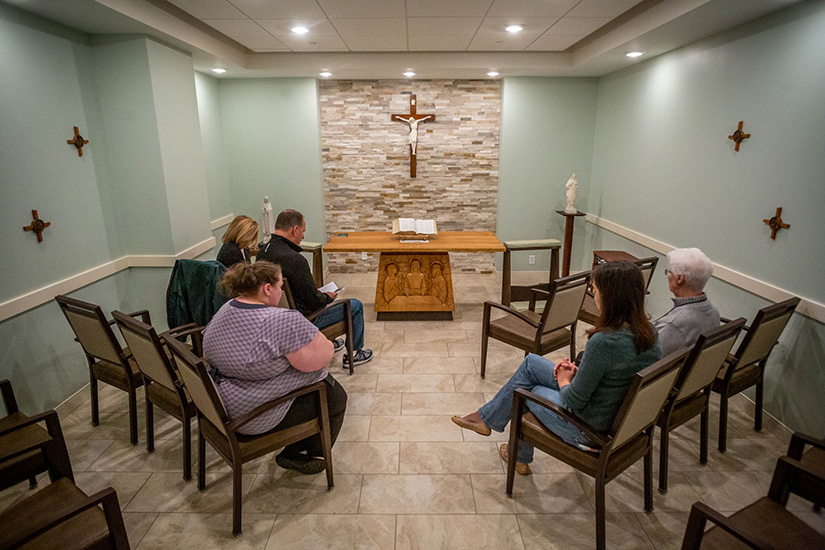 Mike Heck spearheaded an effort to build a chapel at St. Patrick Center. He led the Rosary and distributed the Eucharist during a communion service at St. Patrick Center Downtown on Nov. 7.