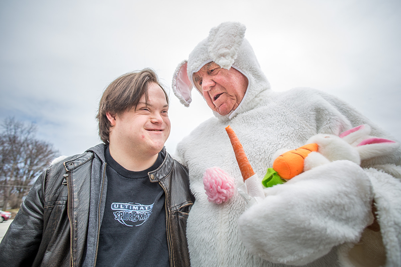 Cody Fingers smiled as he talked with Paul Politte, aka the Easter Bunny, at the Our Lady of Fatima Knights of Columbus 33rd annual Easter egg hunt for children and adults with disabilities on March 25. Politte has dressed in his costume for all 33 years.