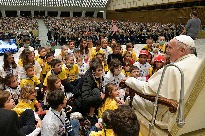 Young patients sat in front of Pope Francis as he led a special audience for patients and workers of Rome's Bambino Gesu children's hospital. The audience was in Paul VI hall at the Vatican Nov. 16.