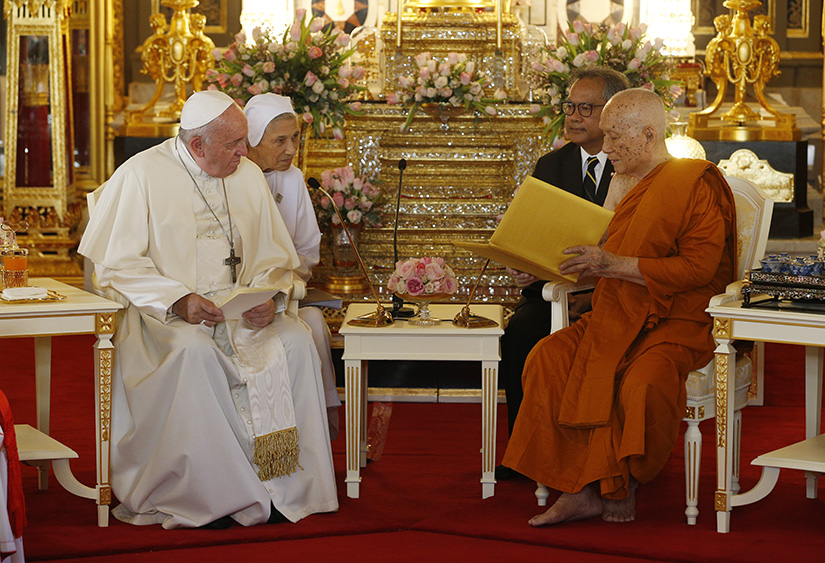 Pope Francis visited with Somdej Phra Maha Muneewong, supreme patriarch of Buddhists, at the Wat Ratchabophit temple in Bangkok Nov. 21.