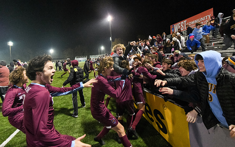De Smet players celebrated with the student section after winning the MSHSAA Class 4 boys championship soccer game against Lee's Summit in the 13th round of penalty kicks on Nov. 23 at World Wide Technology Soccer Park in Fenton.