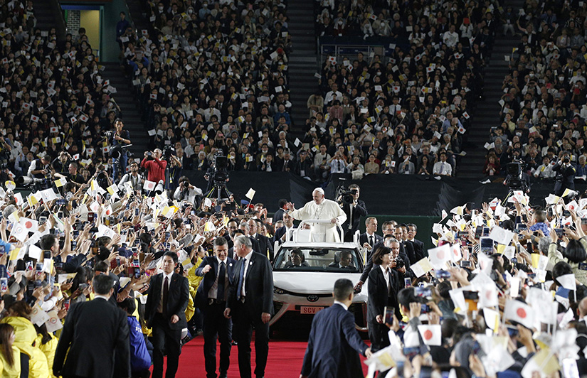 Pope Francis greeted the crowd before celebrating Mass in Tokyo Dome in Tokyo Nov. 25.