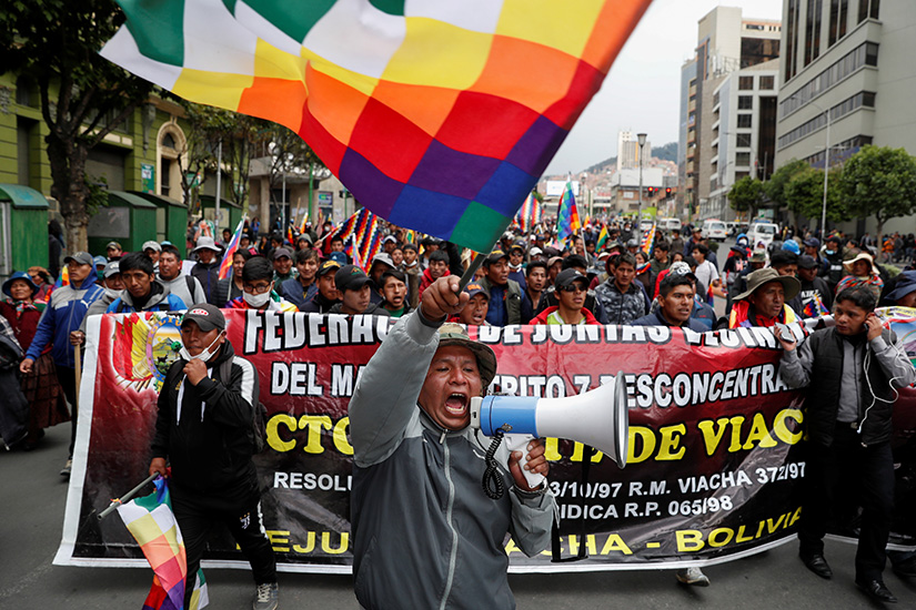Supporters of former Bolivian President Evo Morales protested in La Paz Nov. 14. Bolivian bishops are organizing talks between political factions as protests against the nation's new government become increasingly deadly.