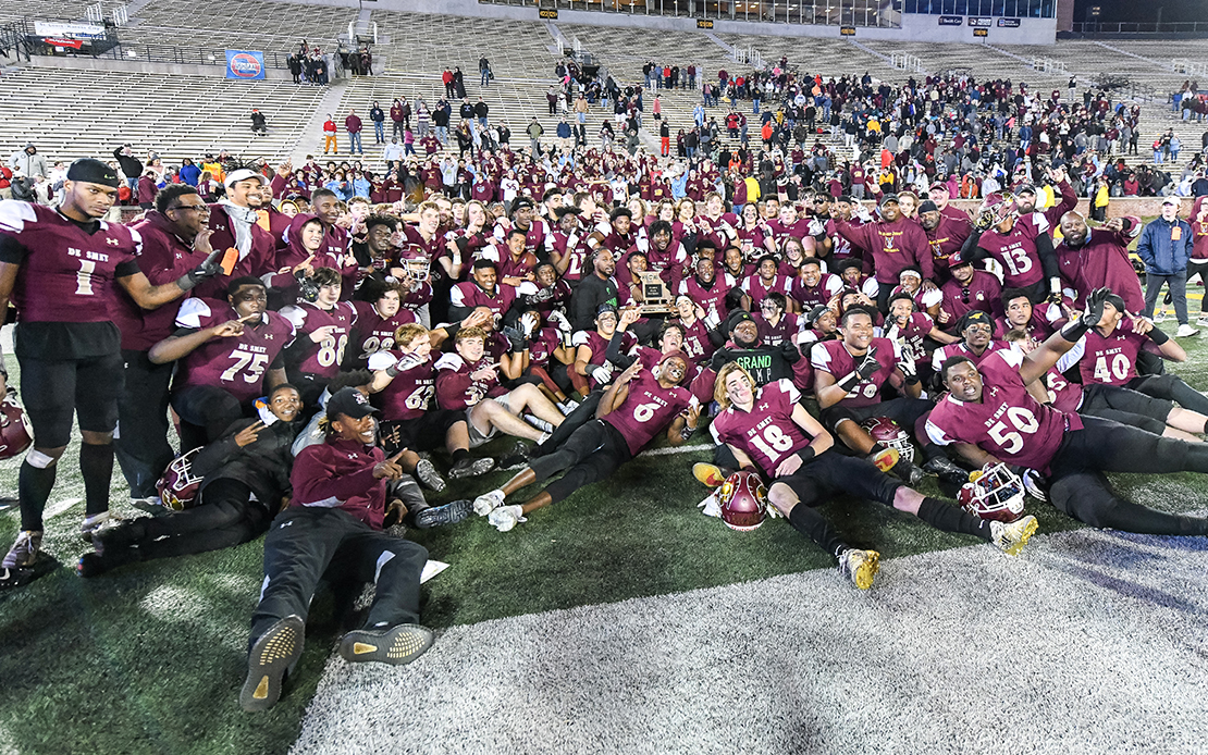 De Smet players and coaches posed after winning the Class 6 State championship football game against Joplin on Nov. 30, at Faurot Field in Columbia, Mo.