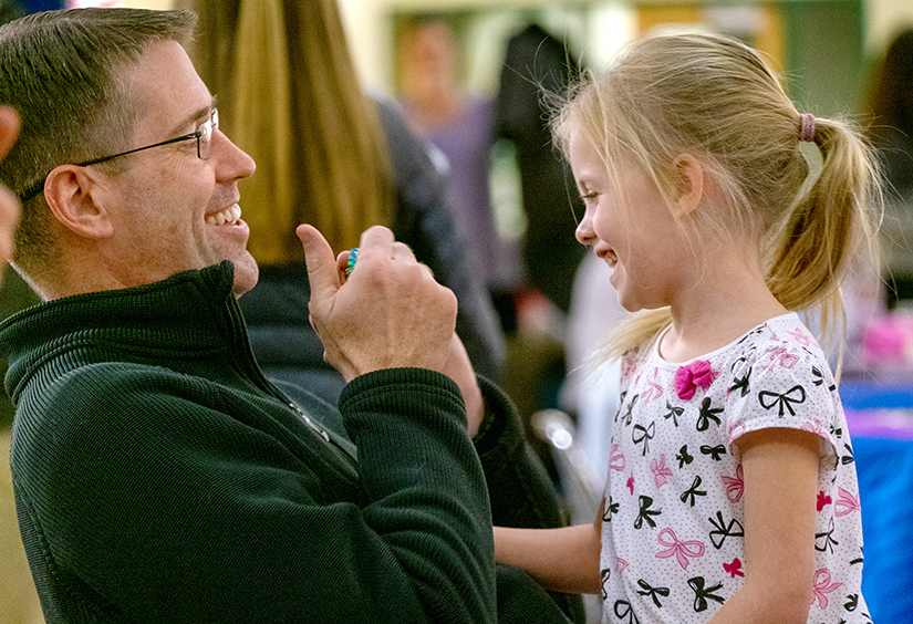 Father Christopher Martin, Pastor of St. Clare of Assisi Parish, visited with Hadley Guntli, 5, at the parish's annual Family Advent Gathering on Dec. 1. The gathering included Advent trivia, Advent story time and a meal.
