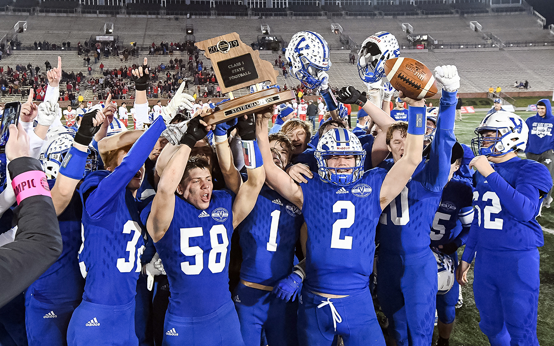 Valle Catholic's Brian Dunlap (2) and Peyton Tucker (58) hoisted the Class 1 championship trophy with teammates after the MSHSAA Class 1 State championship football game against Lincoln High School on Saturday, Dec. 7, 2019, at Faurot Field in Columbia, Mo.