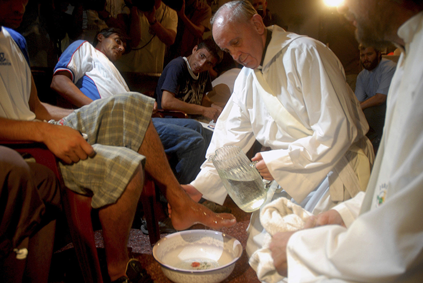 Argentine Cardinal Jorge Mario Bergoglio washed the feet of residents of a shelter for drug users during Holy Thursday Mass in 2008 at a church in a poor neighborhood of Buenos Aires, Argentina. Pope Francis was ordained a priest for the Society of Jesus on Dec. 13, 1969.