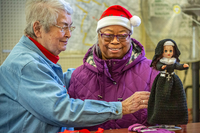 Carlyn Foster delivered a handmade crocheted doll of the Religious Sisters of Mercy as a Christmas present for Sister Carol Ann Callahan, RSM. Sister Carol Ann is the director of the St. Augustine-Wellston Center, which operates an annual Christmas store for residents.