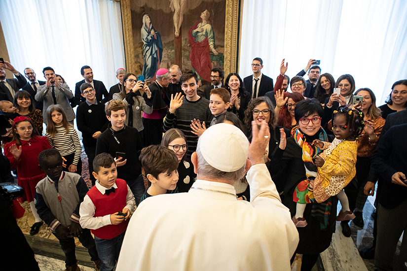 Pope Francis greeted young members of Italy's Catholic Action at the Vatican Dec. 16.