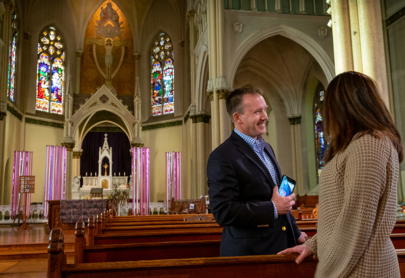 Dave Murphy, left, visited with Candace Hadican after Mass at Most Holy Trinity Church. In 2019, Murphy attended Mass at every church in the Archdiocese of St. Louis, with only a few exceptions for those with limited Mass times.
