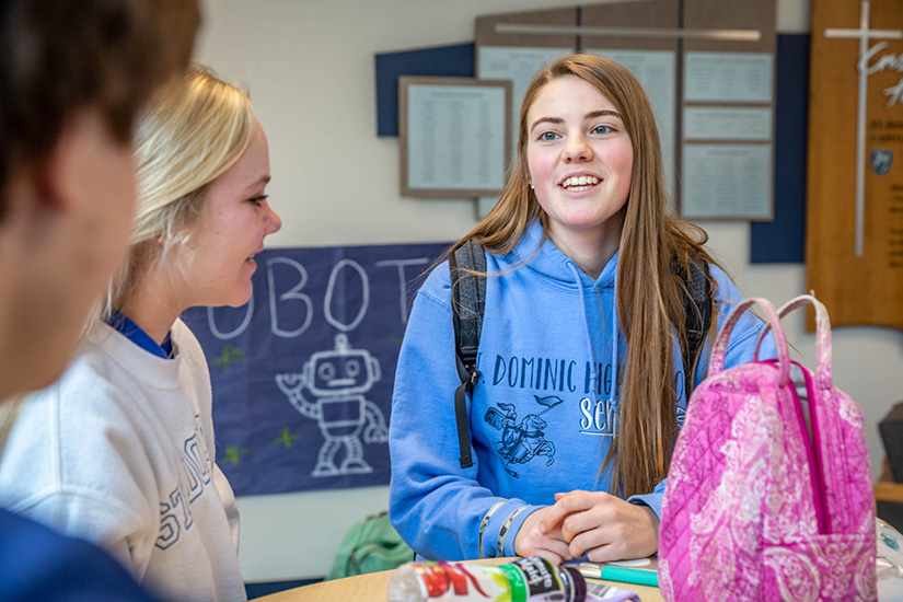 "Alyssa Buchheit talked with friends during St. Dominic High School's ""hour of power"" in O'Fallon. Buchheit, who volunteers with several organizations, is one of the 2020 Dr. Martin Luther King Model of Justice awardees."