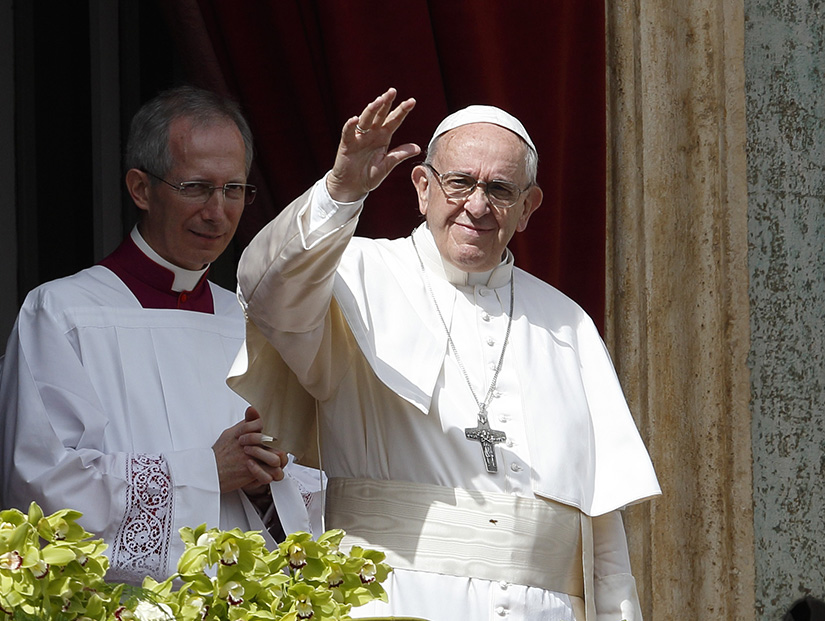 "Pope Francis greeted the crowd after delivering his Easter blessing ""urbi et orbi"" (to the city and the world) from the central balcony of St. Peter's Basilica at the Vatican April 1."