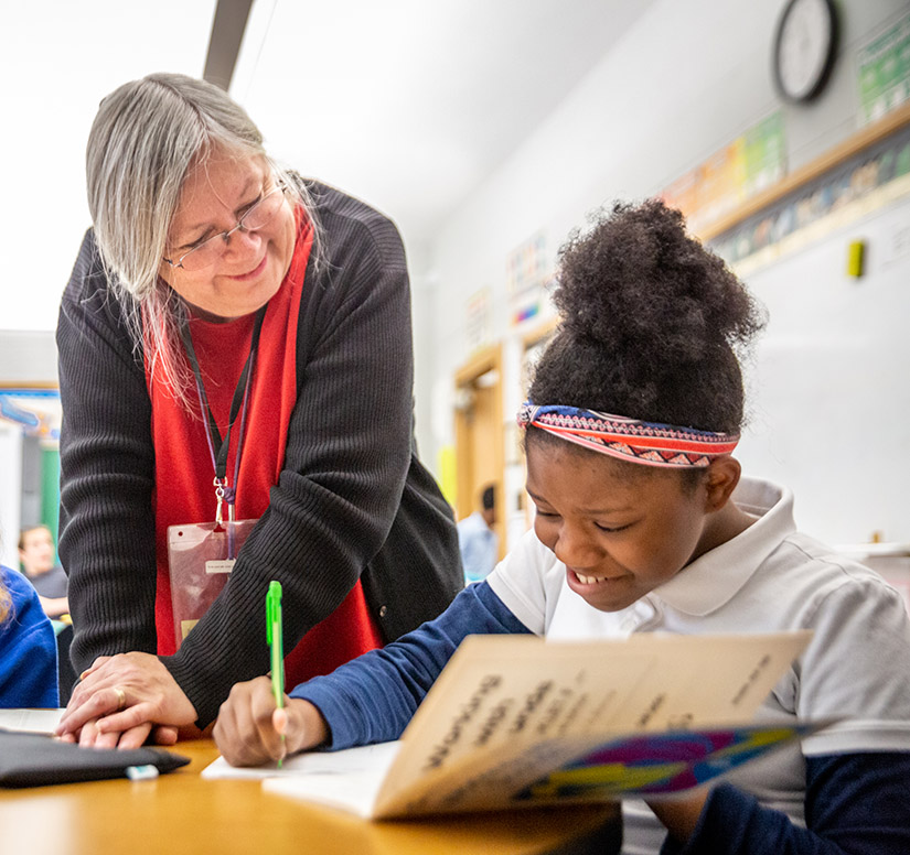 Vicki Houghton helped Bre'lle May during class at Annunziata Learning Center in Ladue. Annunziata is one of the locations for students in the archdiocese with learning disabilities, ADHD, speech and language deficits and autism-spectrum disorders.