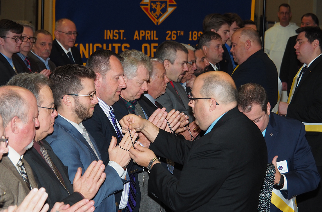 Members of the Knights of Columbus received rosaries Jan. 1, as part of the organization's new ceremony that is designed to condense the Knights of Columbus' three degrees into one. In addition, the ceremony is now conducted in public instead of in a secret, members-only occasion.