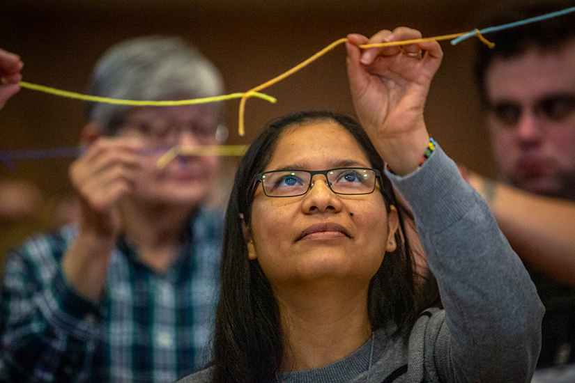 Sister Katty Huanuco, CCVI, held sections of string pieced together that represented working together against human trafficking at a prayer vigil and education session hosted by the U.S. Catholic Sisters Against Human Trafficking at Mercy Conference and Retreat Center in Frontenac Feb. 10.