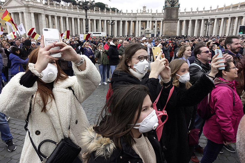People wore masks for protection from the coronavirus while attending the Angelus led by Pope Francis at St. Peter's Square at the Vatican March 1. In spite of many health organizations saying that masks don't provide sufficient protection against the virus, many people choose to wear them.