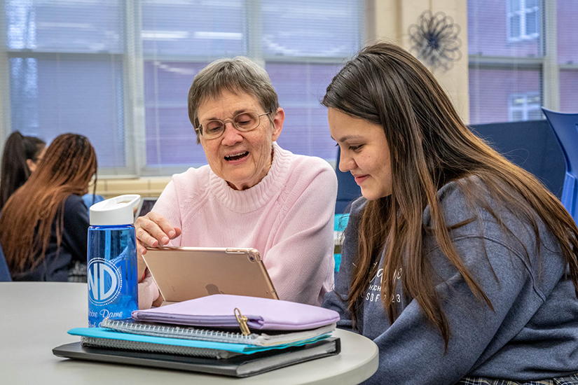 Sister Paulette Zimmerman, SSND, worked with Juliana Gervacio at Notre Dame High School in Lemay Feb. 24. The two are part of a pilot program that is an outgrowth of the English Tutoring Project assisting English language learners in grade schools.