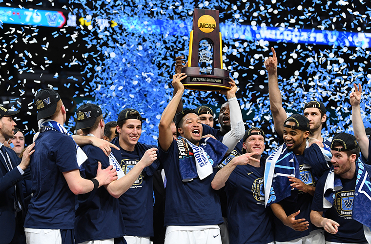 Villanova Wildcats guard Jalen Brunson hoists the national championship trophy after defeating the Michigan Wolverines, 79-62, in the 2018 NCAA men's basketball championship April 2 in San Antonio.