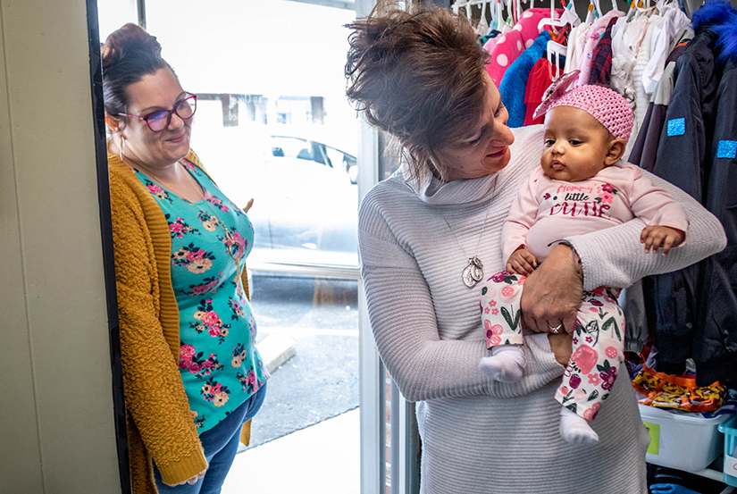 Sue Cooke, right, held Lillian Potter while helping mom Lauren at Mary Queen of Angels pregnancy resource center in O'Fallon March 2. Mary Queen of Angels serves about 500 moms, with a team of about 20 volunteers.