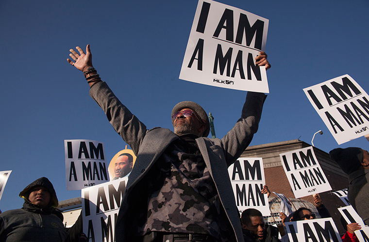 People marched along Beale Street in Memphis April 4 to commemorate the 50th anniversary of Rev. Martin Luther King Jr.'s assassination. The signs are reproductions of those carried in the 1968 sanitation workers strike, which King had been in Memphis to support when he was killed.
