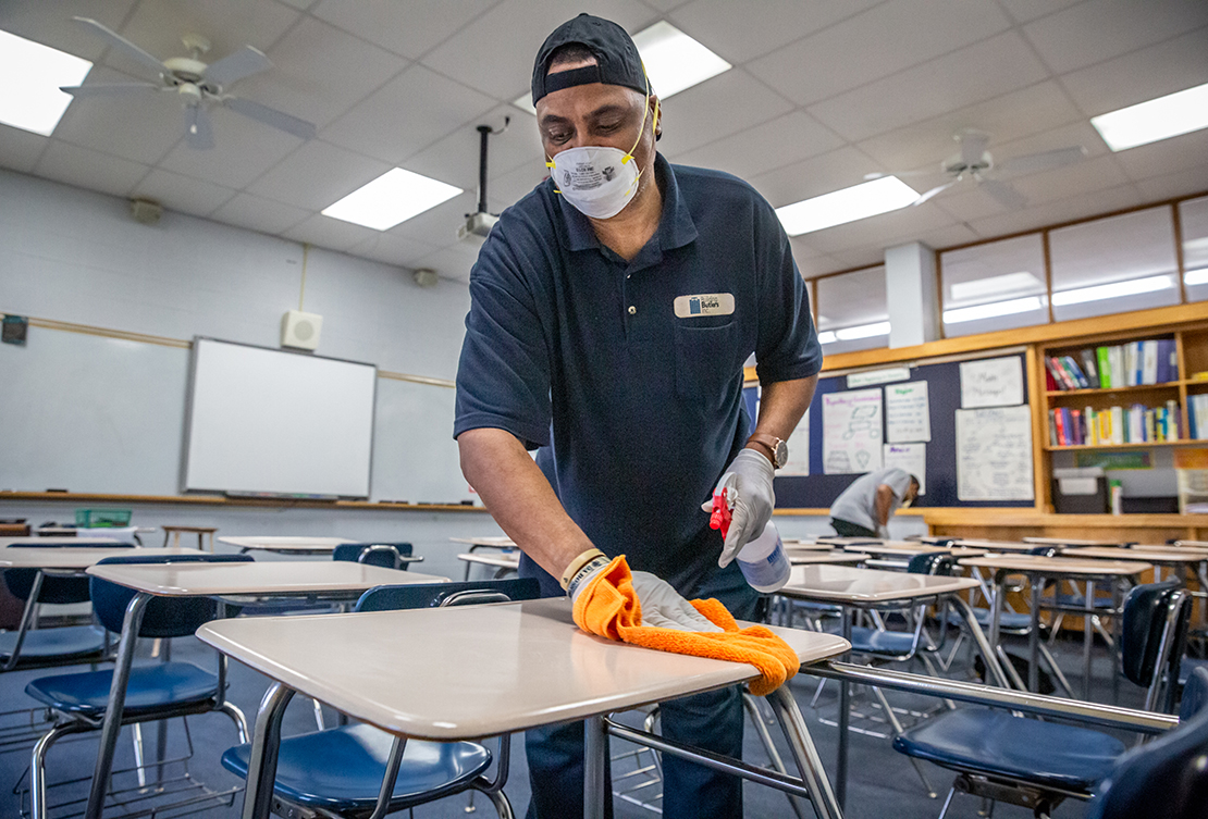Alvin Poe cleaned a classroom at Bishop DuBourg High School in St. Louis on March 18.