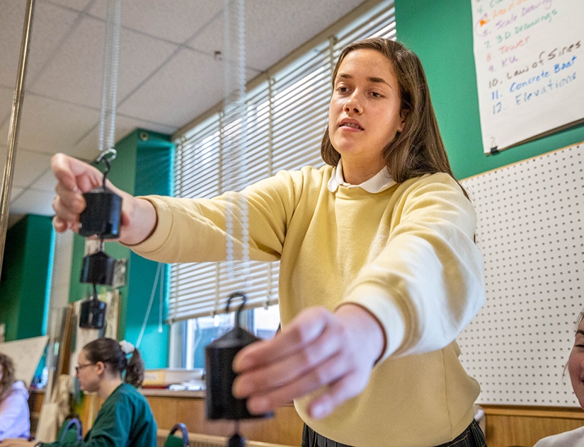 Emma Mueller is among finalists at a St. Louis science fair for her research on the effects of long-term, low-dose ionizing radiation. She worked on an experiment at St. Joseph Academy on March 6.