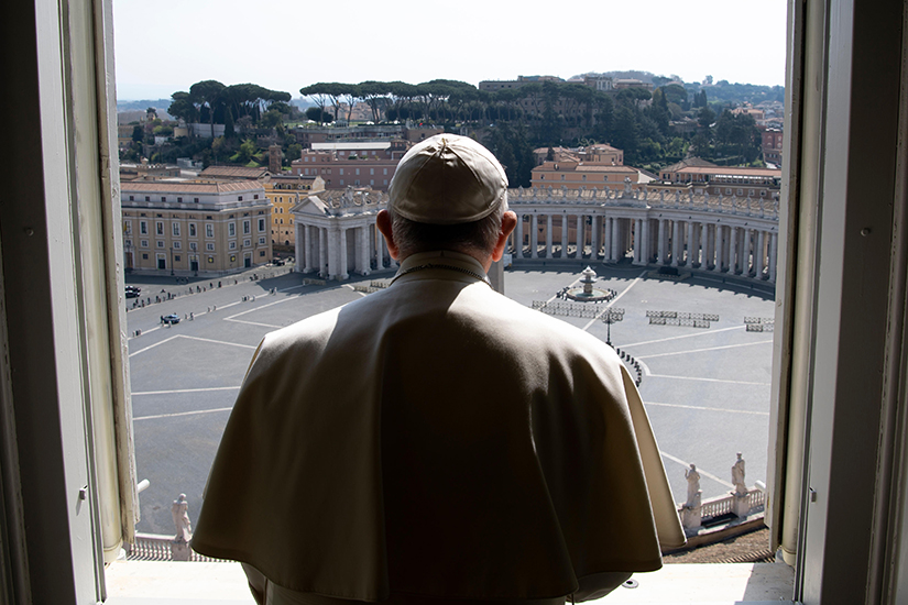 "Pope Francis looked over an empty St. Peter's Square after leading a livestream of the recitation of the Angelus from the library of the Apostolic Palace March 22. The pope will give an extraordinary blessing ""urbi et orbi"" (to the city and the world) at noon St. Louis time March 27 in an ""empty"" St. Peter's Square because all of Italy is on lockdown to prevent further spread of the coronavirus."