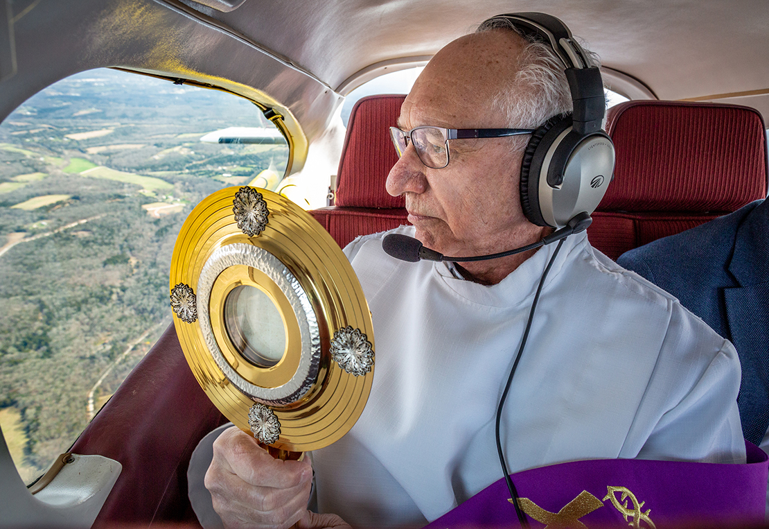 Deacon Tom Gerling offered eucharistic blessings to while soaring over parishes in the Festus Deanery on March 25.