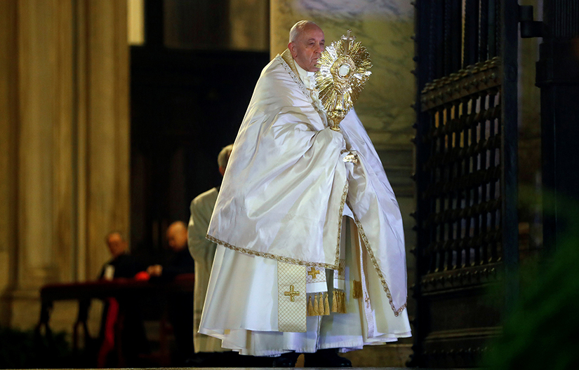 "Pope Francis held the monstrance as he gave his extraordinary blessing ""urbi et orbi"" (to the city and the world) from the atrium of St. Peter's Basilica at the Vatican March 27. The blessing was livestreamed because of the coronavirus pandemic."