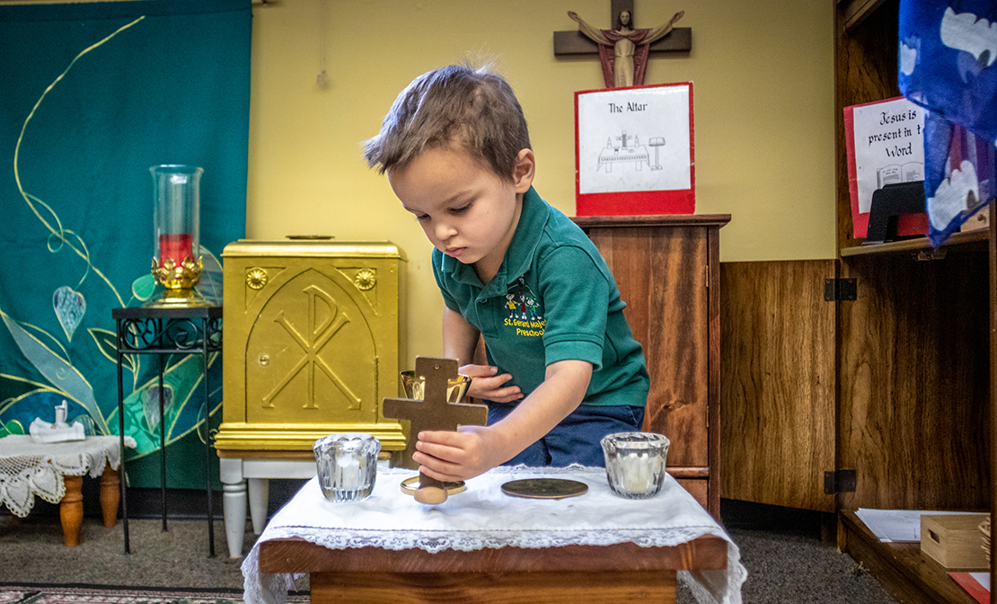 Preschool student Declan Vaughn set up an altar in the Catechesis of the Good Shepherd Atrium at St. Gerard Majella in Kirkwood. Catechesis of the God Shepherd is a religious program designed to nurture children in their faith and to develop a relationship with the Lord.