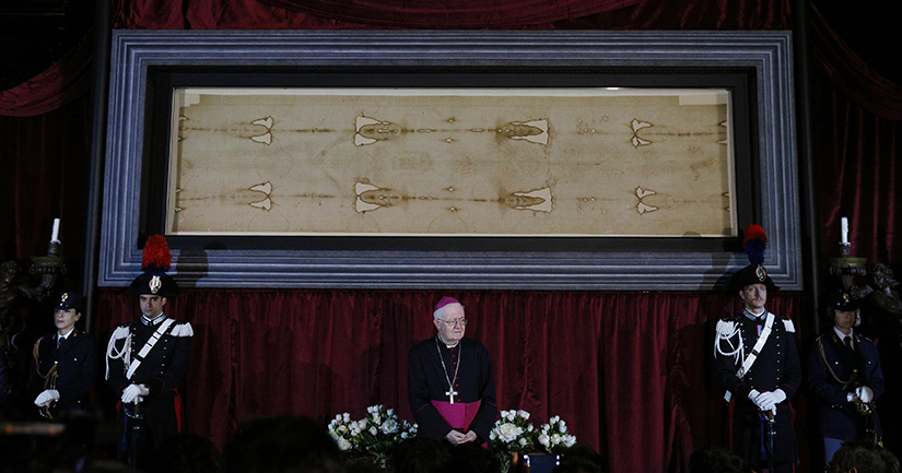 Archbishop Cesare Nosiglia of Turin, papal custodian of the Shroud of Turin, stood in front of the shroud during a preview for journalists in the Cathedral of St. John the Baptist in Turin, Italy, in 2015 before a previous exposition of the shroud.