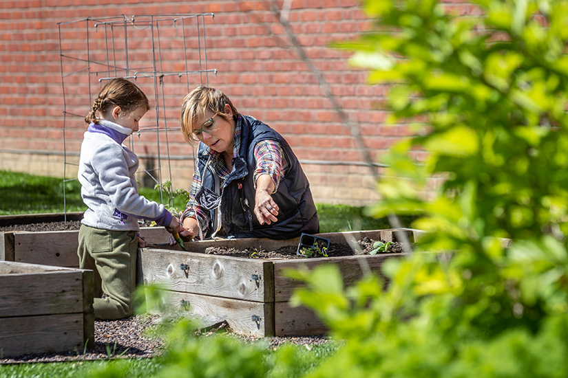 "Jamie Hasemeier planted seeds and seedlings with the help of her daughter, Ruby, a first-grader at Holy Redeemer School in Webster Groves, May 6. Hasemeier urges further action within the Catholic Church to ""take the next step along the process of caring for creation, wherever that step may be."""