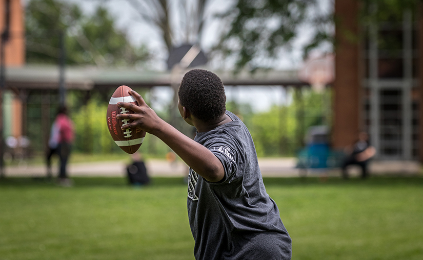 Boys at Marygrove in Florissant played football together on May 26. Marygrove, which provides treatment and support to young people struggling with emotional and behavioral issues, is supported by the Annual Catholic Appeal.