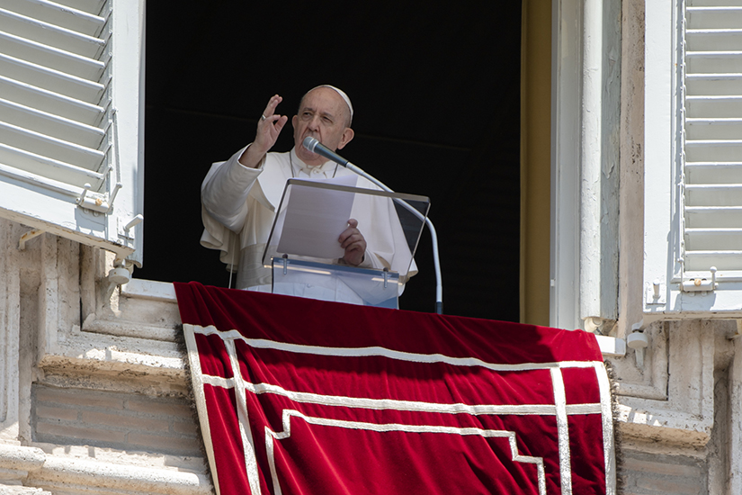 Pope Francis led the Angelus from the window of his studio overlooking St. Peter's Square at the Vatican June 7. The pope urged people to not declare victory against COVID-19 but continue to be careful and follow health precautions.