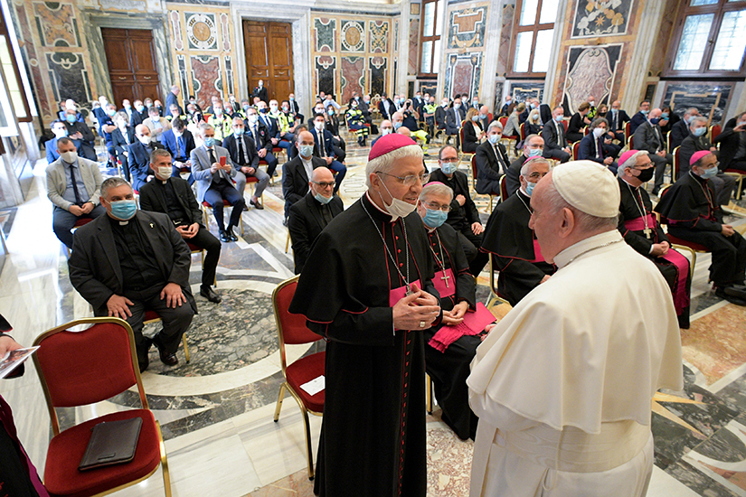 Pope Francis greeted a bishop during an audience with doctors, nurses and health care professionals from Italy's Lombardy region at the Vatican June 20. The Lombardy region in northern Italy suffered the highest number of COVID-19 cases in the country.