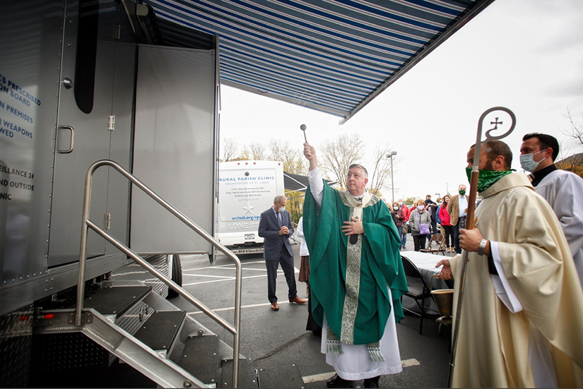 Archbishop Mitchell Blessed the Rural Parish Clinic-Dental vehicle at St. Joseph Parish in Cottleville Oct. 25.