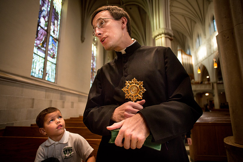Father Anthony Gerber held a relic of St. Maria Goretti that wa given to him on his ordination day. He brought the relic to the Cathedral of St. Peter in Belleville, Ill., on a tour of other relics of St. Maria Goretti.